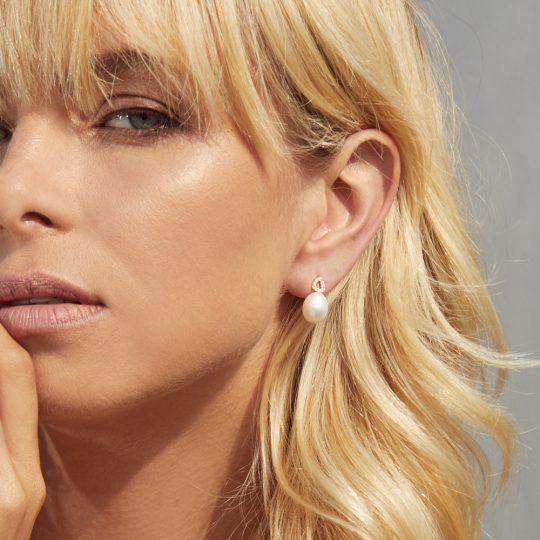 Adina Jozsef - Woman wearing pearl studs with diamonds